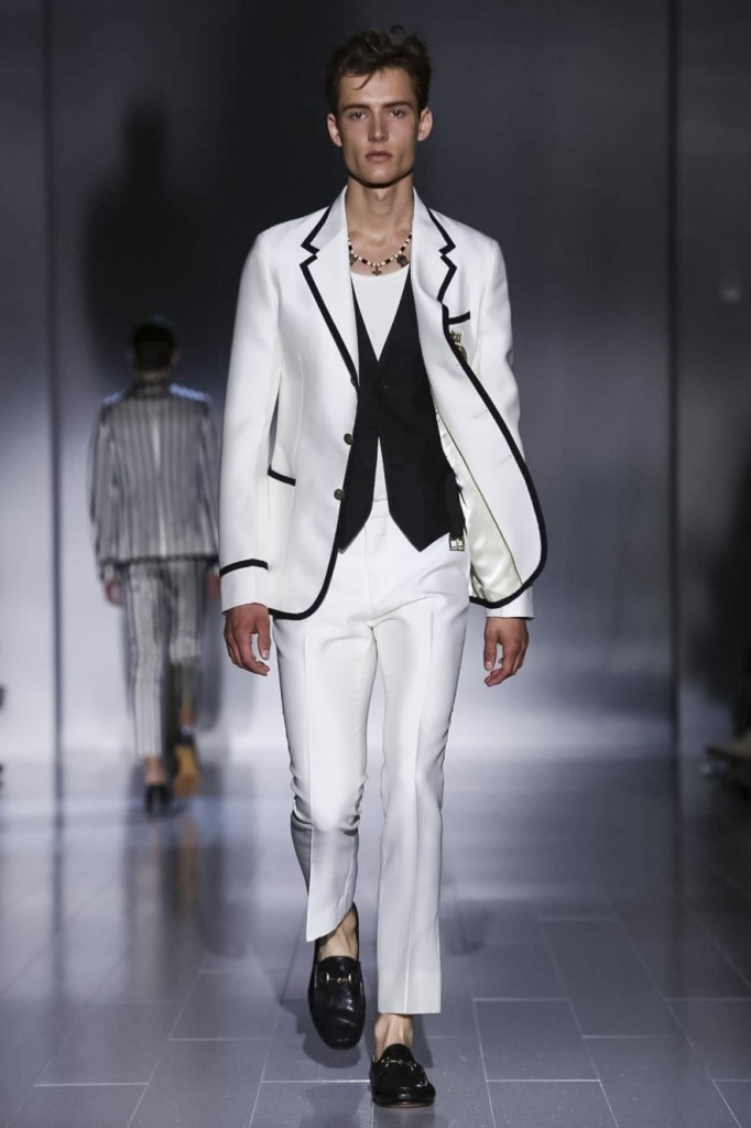 Men without ties in cricket jackets at Gucci