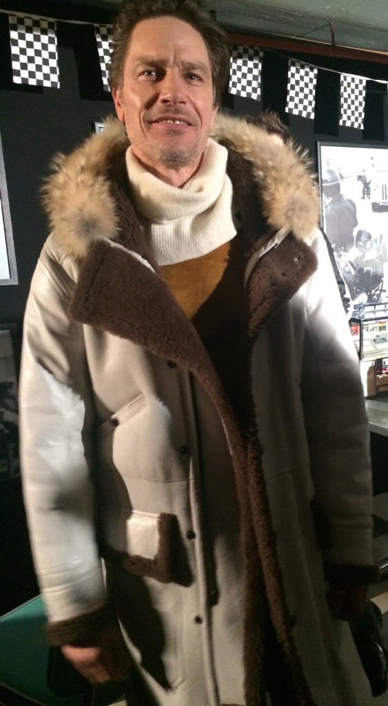 Model evergreen Andre in a big shearling parka