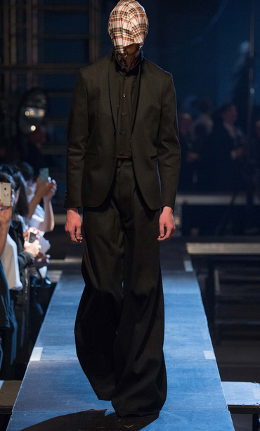 Neat tailoring with elephant pants Raf Simons