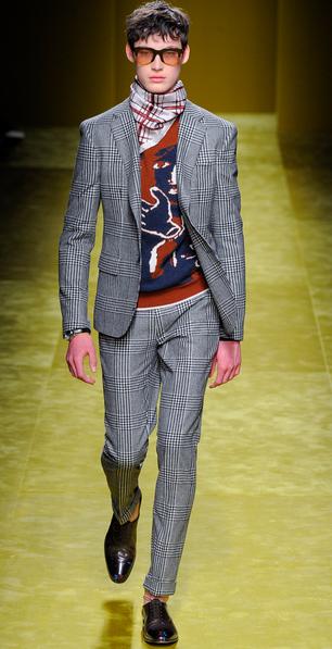 Classic suit, colorful sweater Salvatore Ferragamo