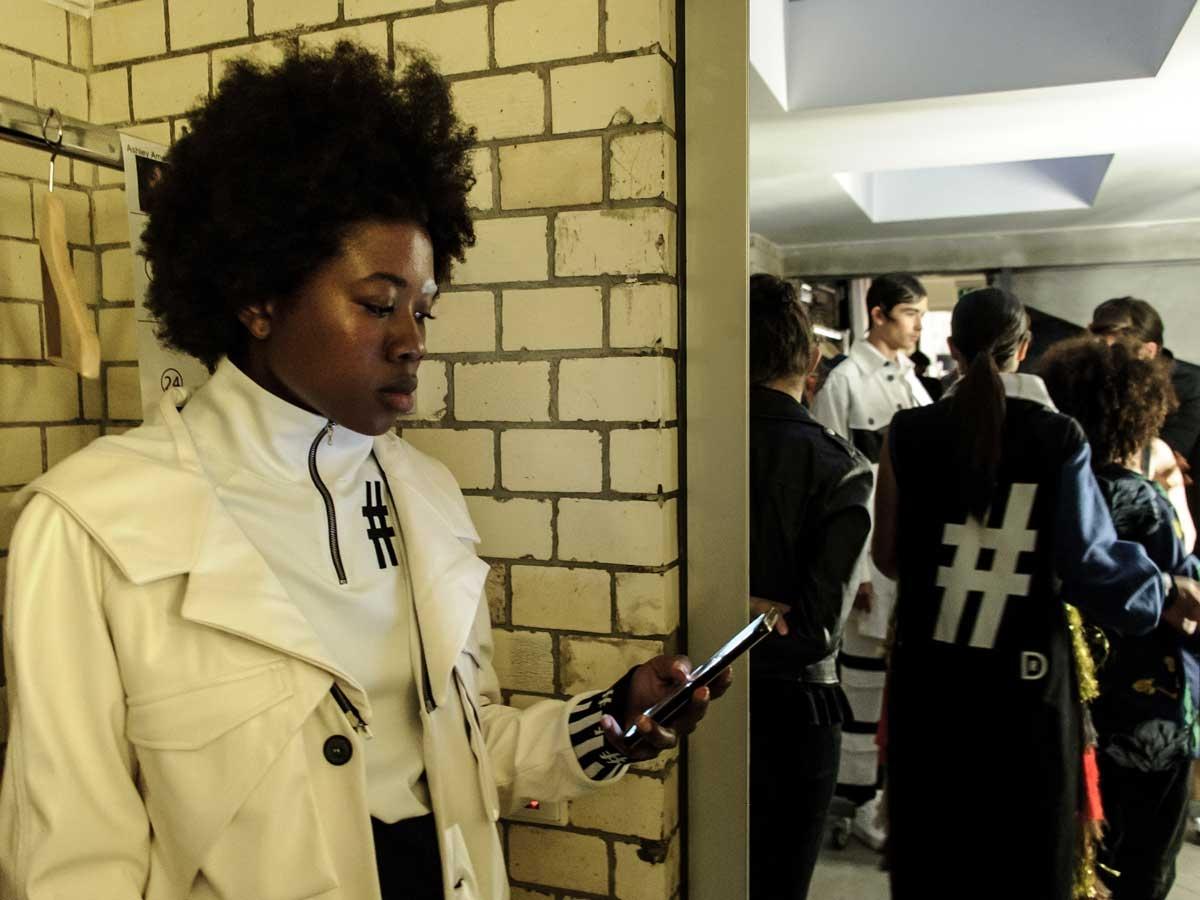 Damur Huang women white jacket white wall people