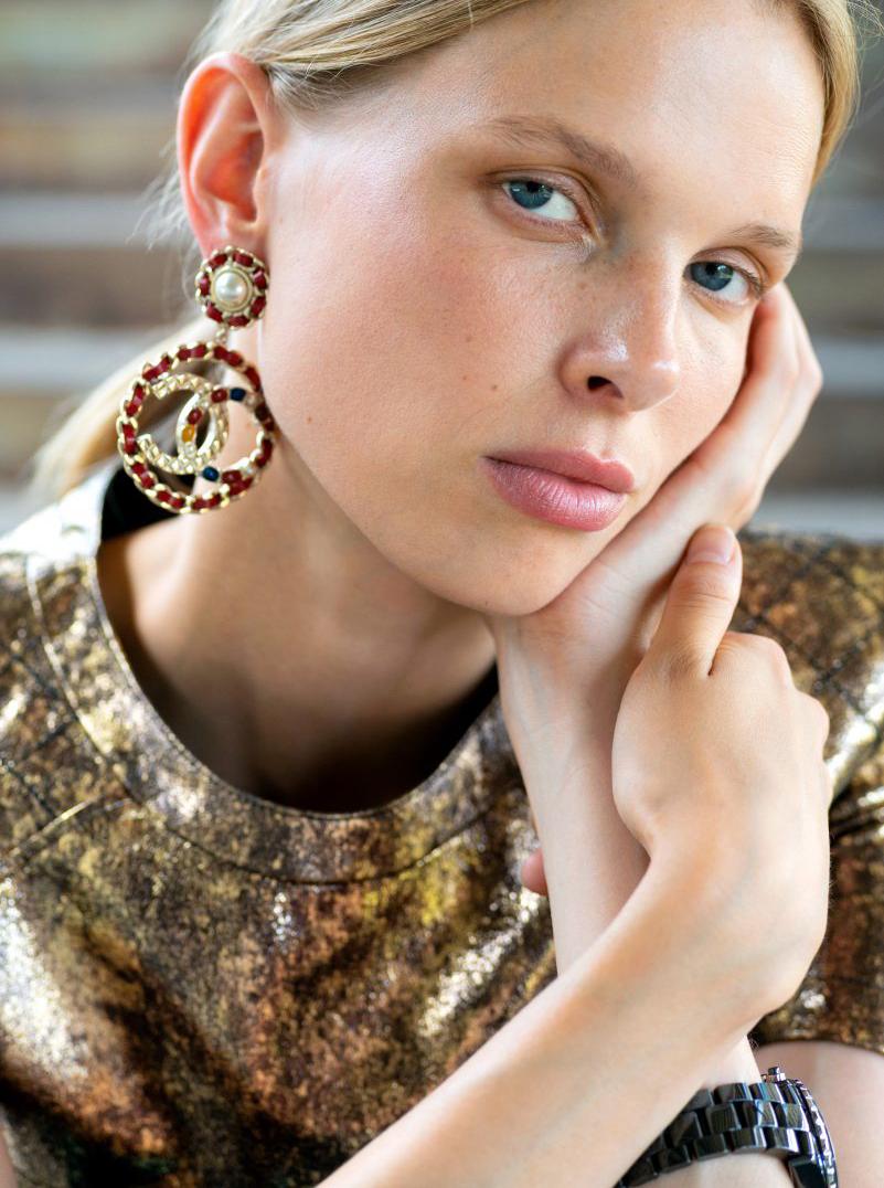 Model blonde Chanel Earrings gold Portrait