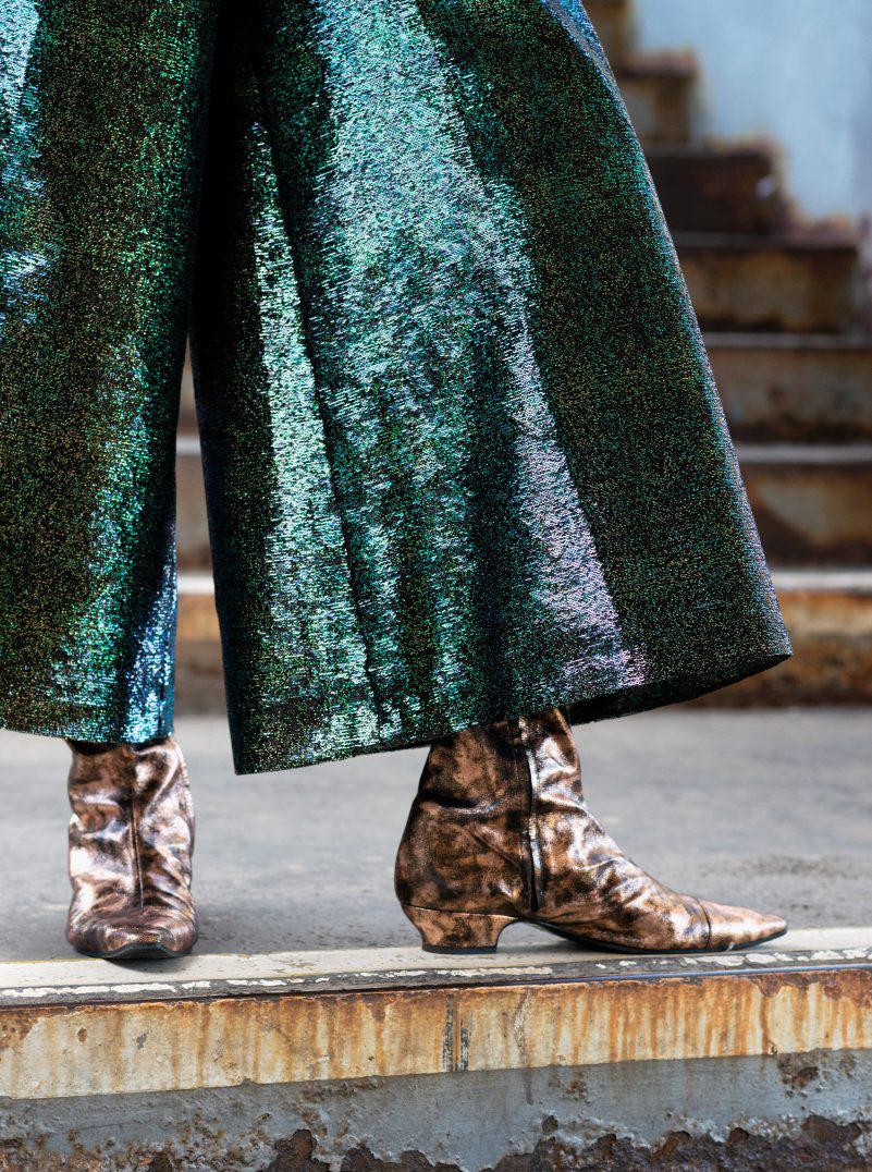 Chanel gold top green pants cowboy boots bronze