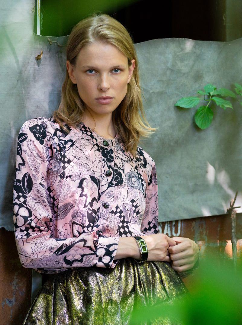 Chanel model blonde green pink top gold skirt
