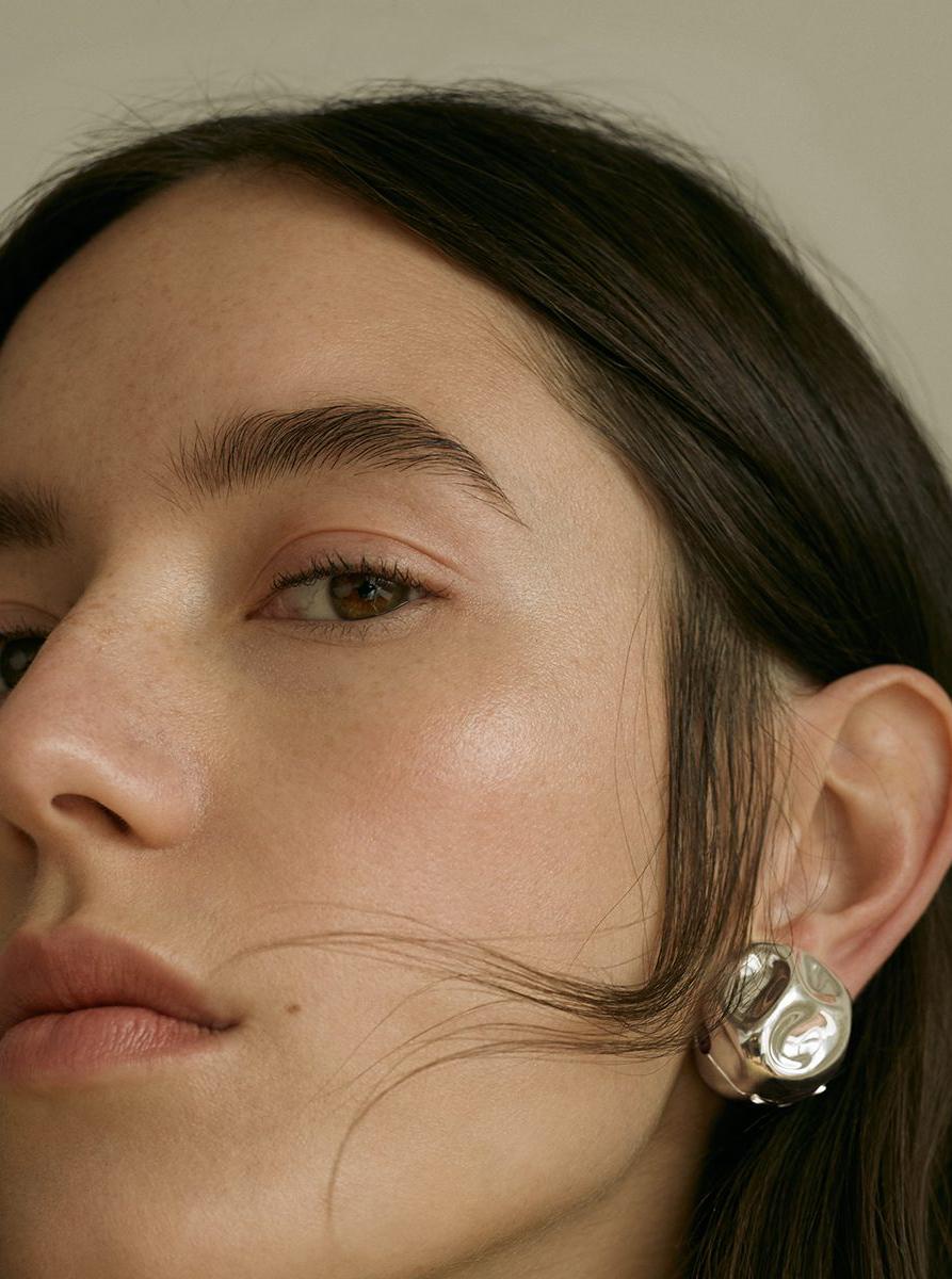 model brown hair highlighter earring portrait
