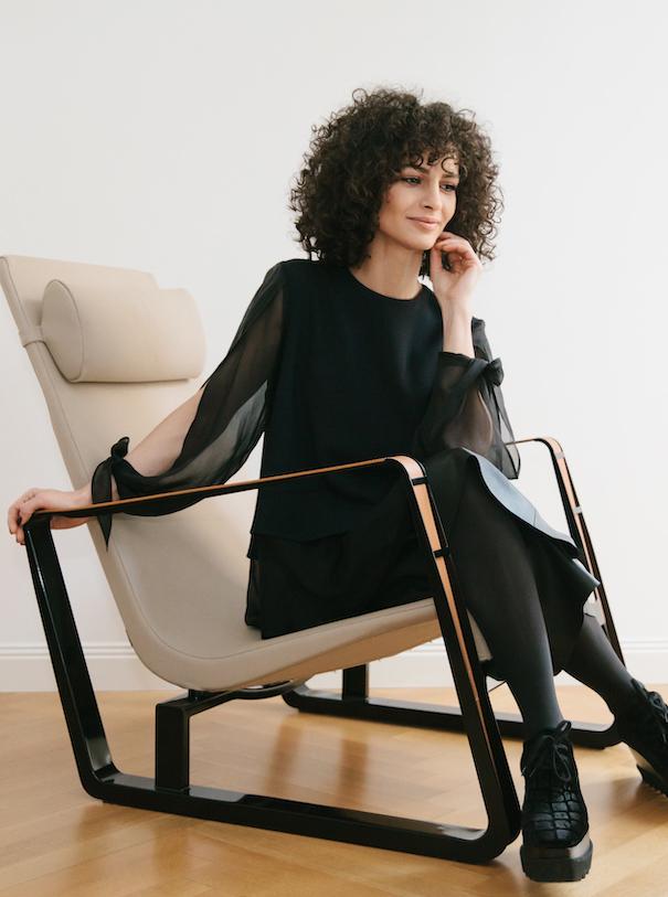 Nobieh Talaei Photo Portrait Black Dress White Chair White Wall