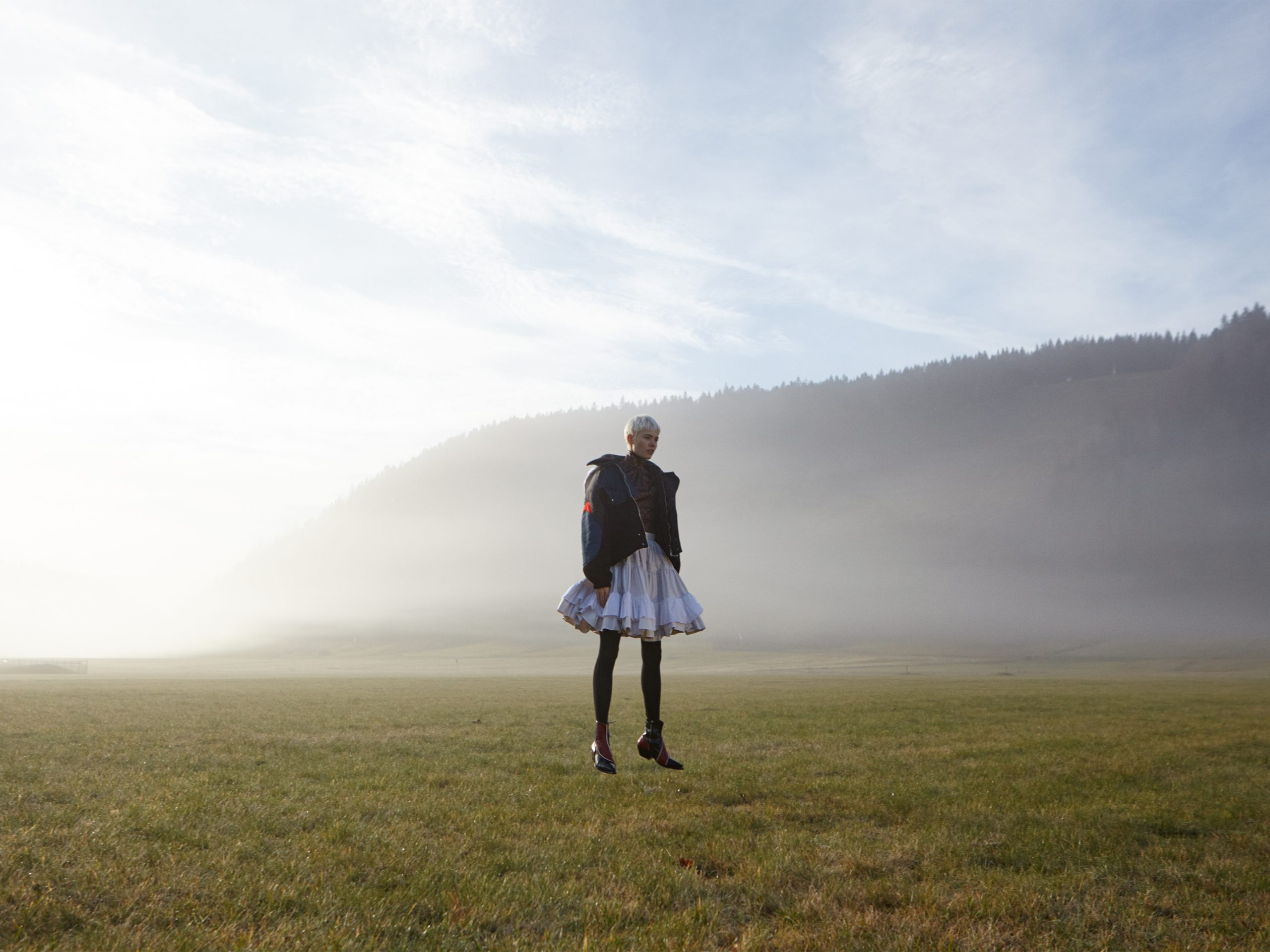 of fog and falls jumping into the fog Maike in Black Forest Louis Vuitton