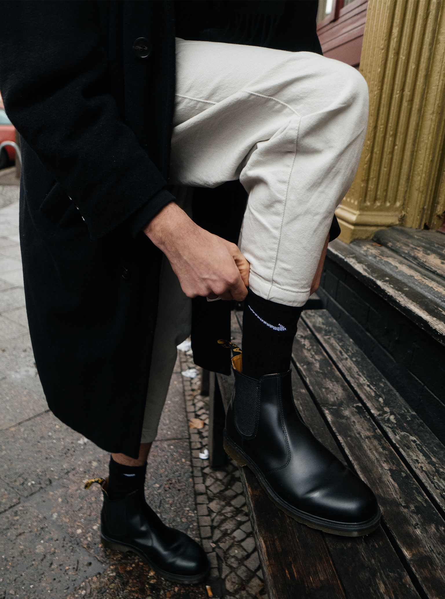 White trousers black boots